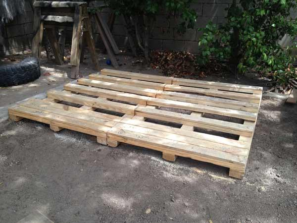 arranging pallets for playhouse