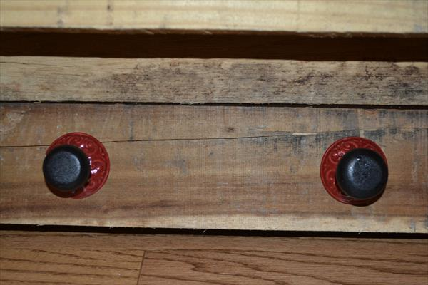 diy pallet shelf with rustic knobs