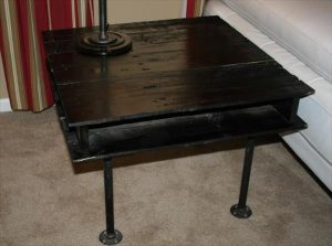handmade black pallet and iron pipe side table