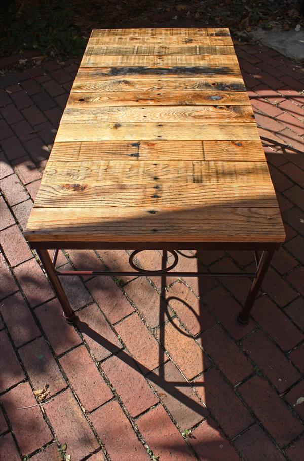 repurposed pallet coffee table with painted iron base