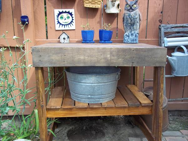 repurposed pallet garden work bench with shelf