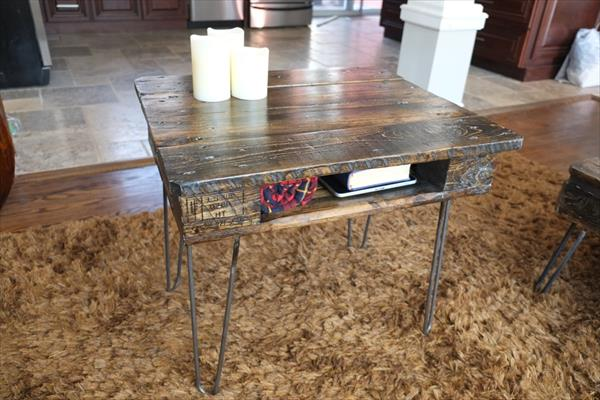 repurposed pallet end table with storage and metal hairpin legs.
