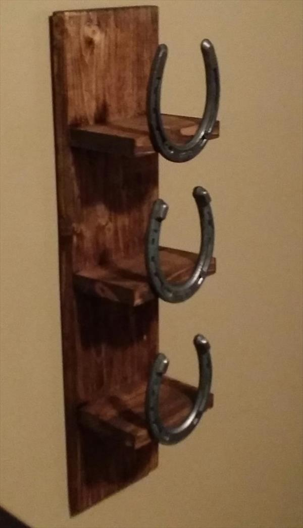 recycled pallet and horseshoe bathroom towel rack