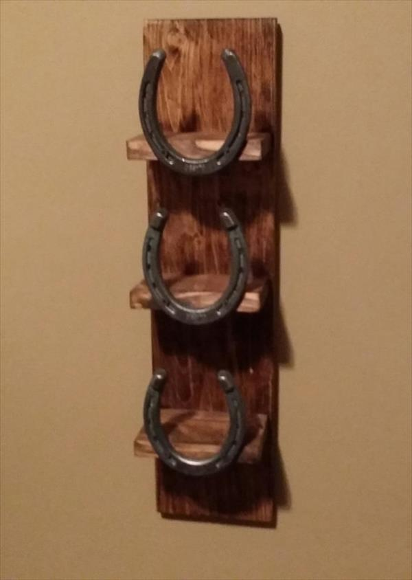 repurposed pallet and horseshoe towel rack
