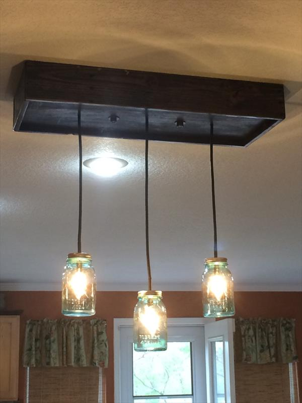 handmade pallet and Mason jars chandelier