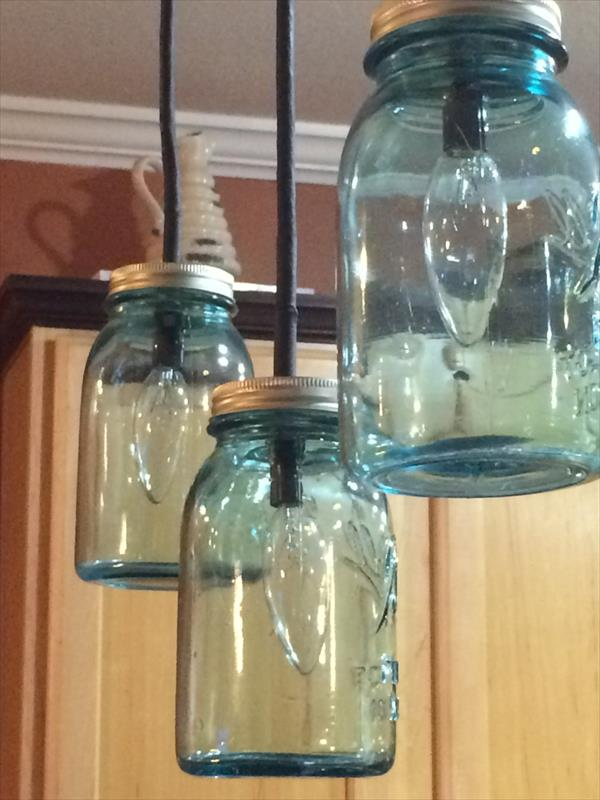wooden pallet and blue Mason jars chandelier