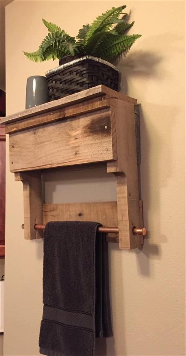 wooden pallet bathroom shelf with copper rod towel rack