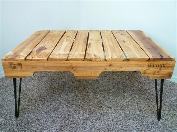 repurpsed pallet coffee table with 3 rod metal hairpin legs