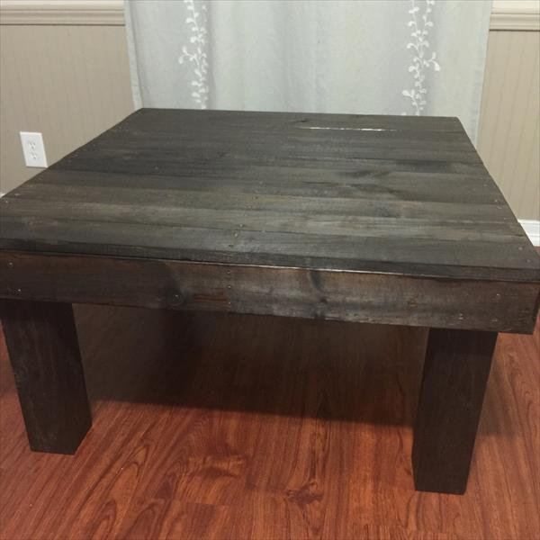 handcrafted pallet and metal coffee table with short beefy legs