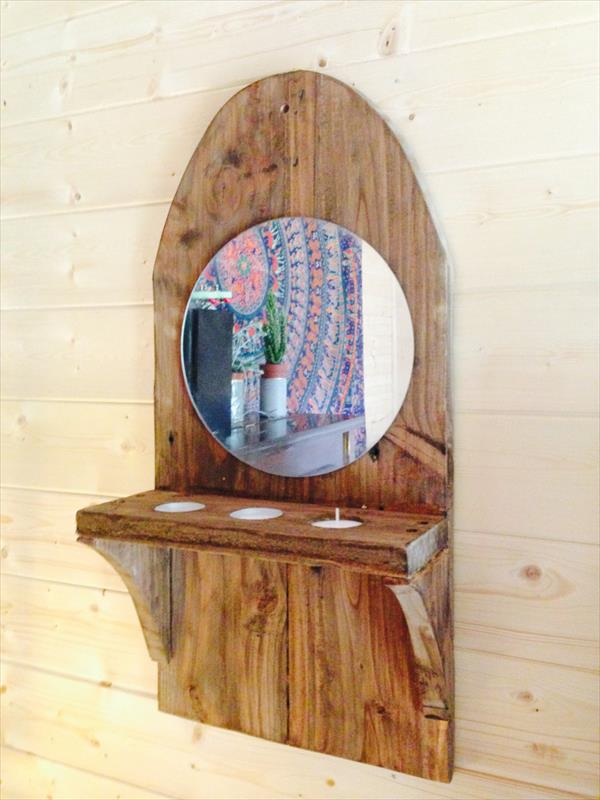 Repurposed pallet wall mirror with triple candle holder