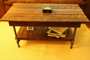 diy wooden pallet coffee table with metal pipe base