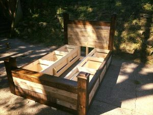Repurposed pallet bed frame drawers and headboard