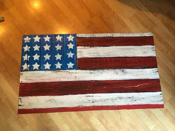repurposed pallet coffee table with painted country flag