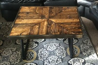 repurposed wooden pallet coffee table with metal pipe base