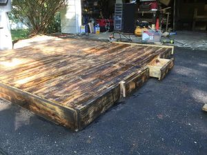 scorched pallet platform bed with drawers