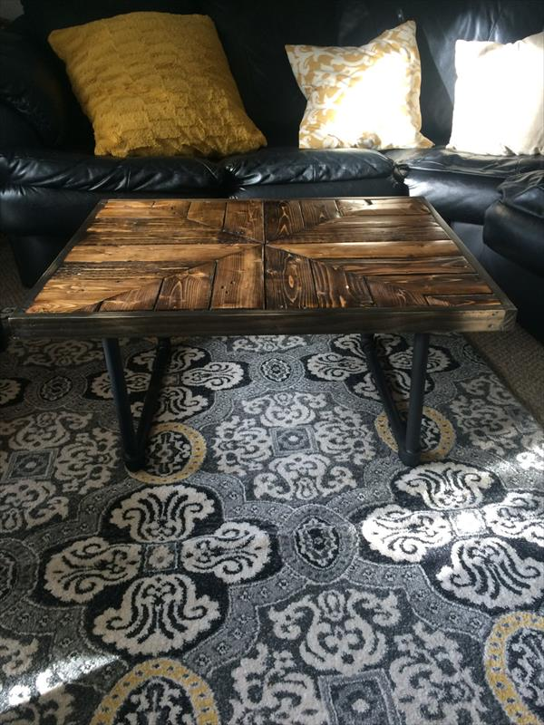 recycled pallet coffee table with metal pipe legs