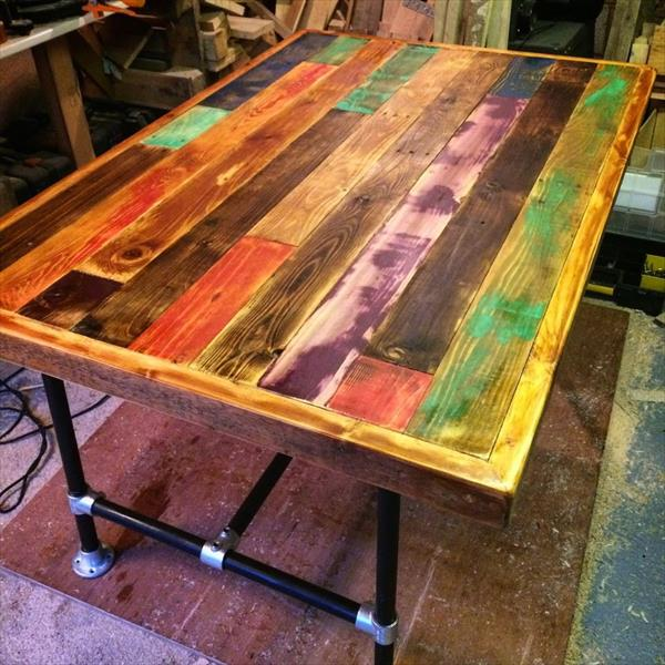 wooden pallet dining table with metal pipe base