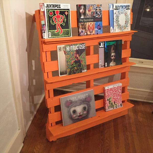 orange painted pallet bookshelf