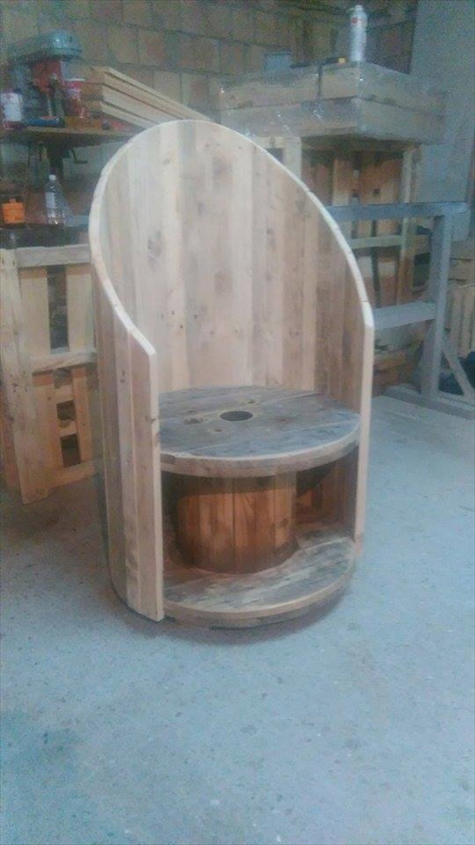 Wooden pallet and cable spool coffee chair