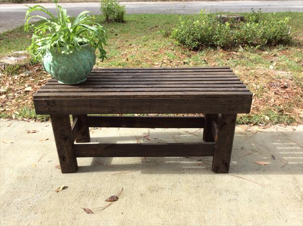 low-cost wooden pallet dark stained bench