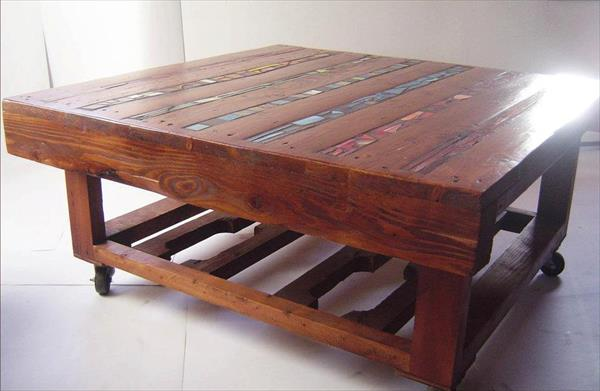dark stained pallet coffee table with colorful ceramic lines inlay