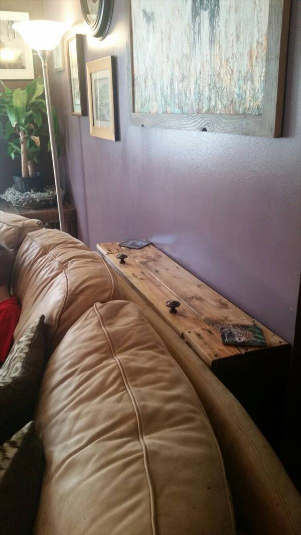 recycled pallet behind sofa table