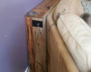 low-cost wooden pallet behind sofa table
