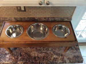 repurposed wooden pallet dog feeder