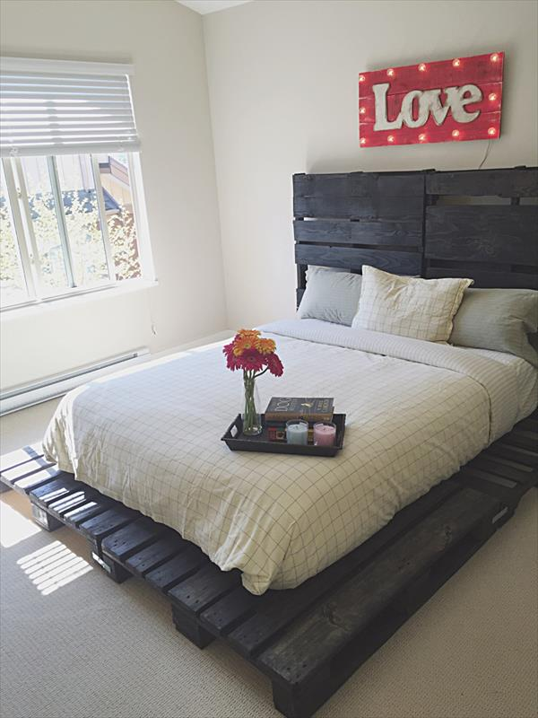 recycled pallet painted platform bed