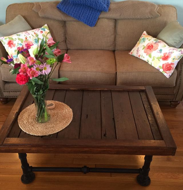 industrial pallet and metal pipe coffee table