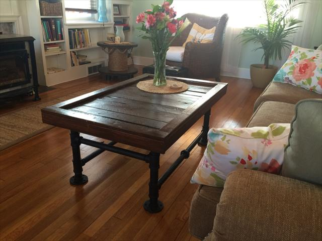handcrafted wooden pallet coffee table with metal pipe legs