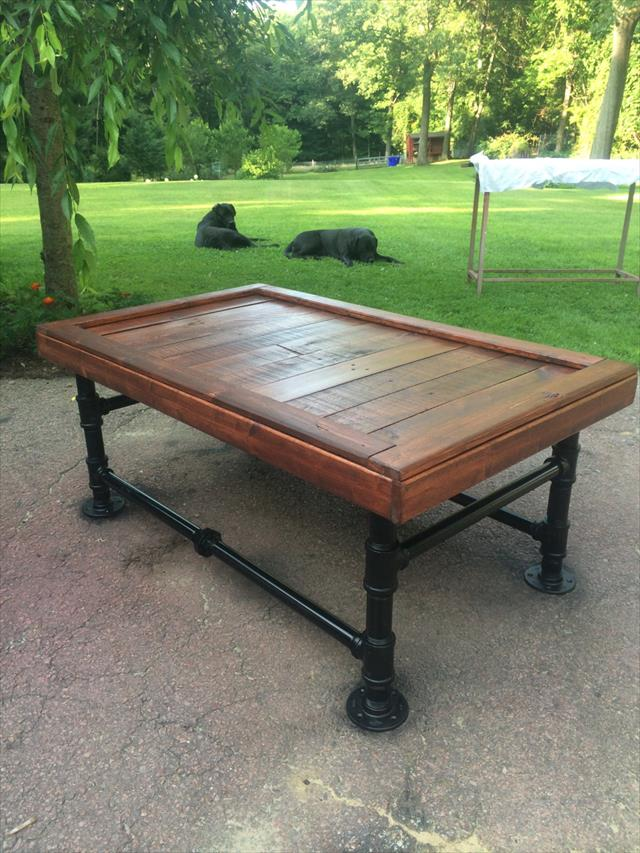recycled pallet and old metal pipe coffee table