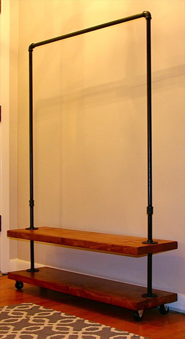 upcycled wooden pallet and metal pipe clothing rack