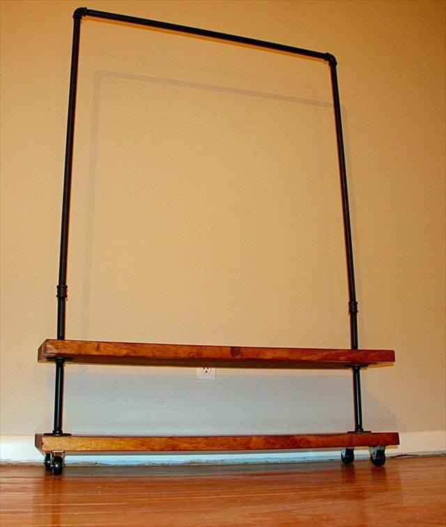 handmade wooden pallet and metal pipe clothing rack